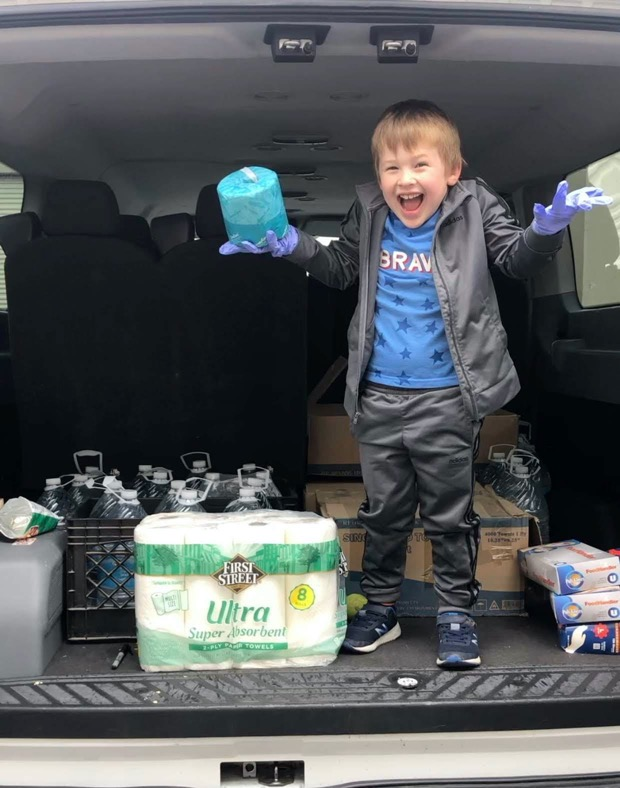 Kid in the truck delivering supplies