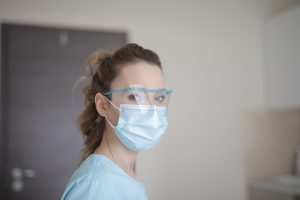nurse wearing a plastic face shield